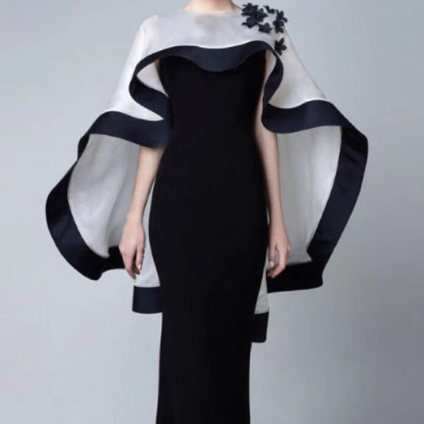 Black carpet gown evening dress featuring black with white cape