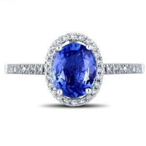 A women's jewellery wedding/ engagement ring featuring a solid 18k white gold 7x5mm oval cut Natural Blue Sapphire stone and natural diamonds from Madaame.co.uk