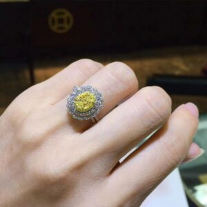 A women's White Gold (AU750) Wedding Ring featuring Certified Classic 1 CT Oval Cut Natural Yellow Diamond from Madaame.co.uk