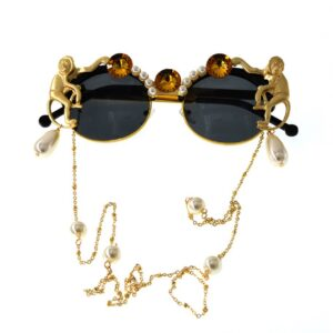 Vintage fashion style sun glasses featuring monkeys and neck chain