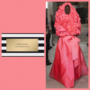 Haute couture powder pink ball gown embodies the theme of voluminous ruffles and exaggerated embellishments. This gown envelops the head and comes in ruched satin roses.